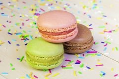 Macrons in various colors on table Stock Photo