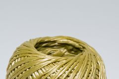 Macrop image of a bobbin rope to tie boxes with royalty free stock image