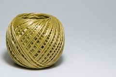 Macrop image of a bobbin rope to tie boxes with royalty free stock images
