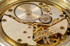 Macrophoto der mechanischen Uhr Stockfotos