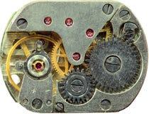 Macrophoto of old clockwork background. Macrophoto of a tiny old clockwork background Stock Photos
