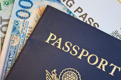 Macros shot of passport on foreign currency Royalty Free Stock Photos