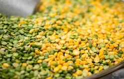 Macroshot of green and yellow mixed lentils, sale on local city stock image