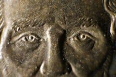 Macroweergeven van de Ogen van Abraham Lincoln op Dollarmuntstuk stock afbeelding