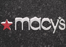 Macy's sign. Covered with snow on a snowy december day Stock Image