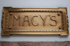 Macy's Sign. A polished bronze sign on the original Macy's Department Store on 34th street at Herald Square in New York City Royalty Free Stock Image