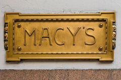 Macy's Sign. NEW YORK CITY - DEC 2:  Brass sign plaque outside flagship Macy's Department Store at Herald Square in NYC on Dec 2, 2011. Macy's was founded by Stock Images