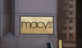 Macy`s Store Sign. A gold Macy's department store sign on a mall Stock Images