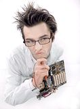 Mad. Technician repairing mainboard, handsome men royalty free stock images