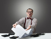 Mad accountant. Humorous portrait of an angry accountant holding a report stock image