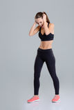 Mad angry fitness girl closed her ears and screaming Royalty Free Stock Photography