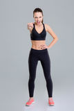 Mad angry fitness woman screaming and pointing on you Stock Photo