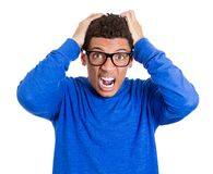 Mad, angry nerdy young man Royalty Free Stock Photography