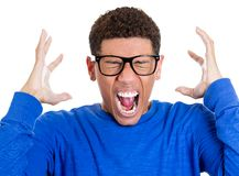 Mad, angry nerdy young man Royalty Free Stock Images