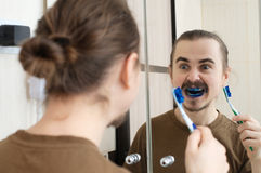 Mad about april joke. Caucasian man mad about april joke with tooth brush Stock Photo