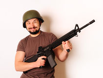 Mad armed man. In protective cask royalty free stock image