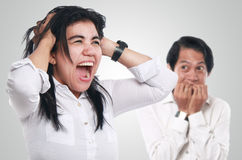 Mad Asian Businesswoman and Scared Man Stock Images