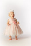Mad Baby Girl in Party Dress and Hat Stock Photo
