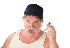 Mad big man. Angry big man in tee shirt with cigar and baseball cap Stock Photography
