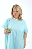 Mad blonde woman patient in hospital gown Stock Image