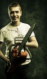 Mad maniac. Mad bloody maniac with chainsaw over grunge background royalty free stock images