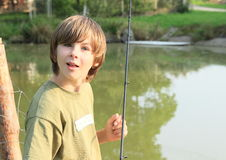Mad boy with fish-rod Royalty Free Stock Images