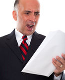 Mad business man holding pages Stock Photos