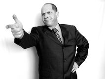 Mad Businessman. Pointing the finger with hand on hip,   White background in Black and White Stock Images