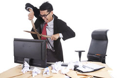 Mad businessman cutting computer Stock Photo