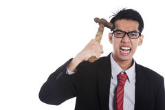 Mad businessman hit his head with hammer Stock Image
