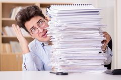 The mad businessman with piles of papers Stock Photos