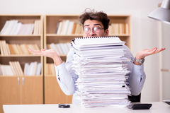 The mad businessman with piles of papers Royalty Free Stock Images