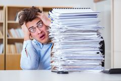 The mad businessman with piles of papers Stock Images