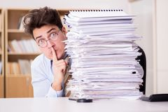 The mad businessman with piles of papers Royalty Free Stock Photography
