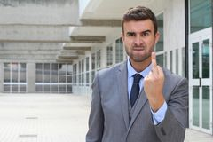 Mad businessman showing rage with middle finger.  Royalty Free Stock Image