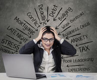 Mad businesswoman with many pressure Stock Images