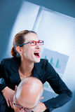Mad businesswoman strangling a man Royalty Free Stock Image