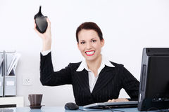 Mad businesswoman throwing her shoe. Royalty Free Stock Photo