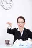 Mad businesswoman throwing paperball. Stock Photography