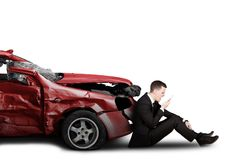 Mad businessman with damaged car Royalty Free Stock Image