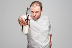 Mad Chef Holding Cream Whipper Royalty Free Stock Photos