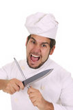 Mad chef sharpening a knife Stock Photography