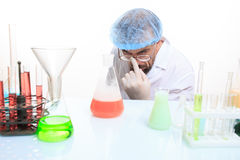 Mad chemist in the lab doing reaction Stock Images