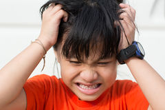 Mad Child. Because lice on the head Stock Photography