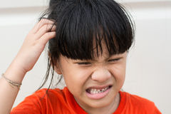 Mad Child. Because lice on the head Royalty Free Stock Images