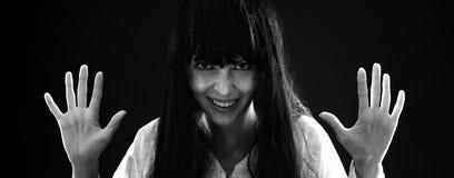 Mad and crasy halloween woman on black Stock Photo