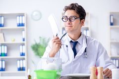 The mad crazy doctor preparing to eat rabbit Royalty Free Stock Photo