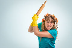Mad and crazy housewife woman with kitchen roller Royalty Free Stock Image