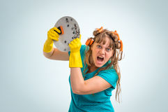 Mad and crazy housewife woman with kitchen roller Stock Photography