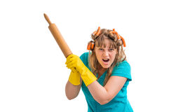 Mad and crazy housewife woman with kitchen roller Royalty Free Stock Images